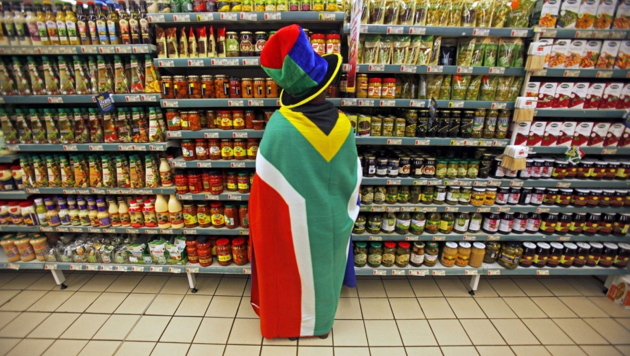 woman-south-african-flag-draped-around-her-shops-groceries-pretoria